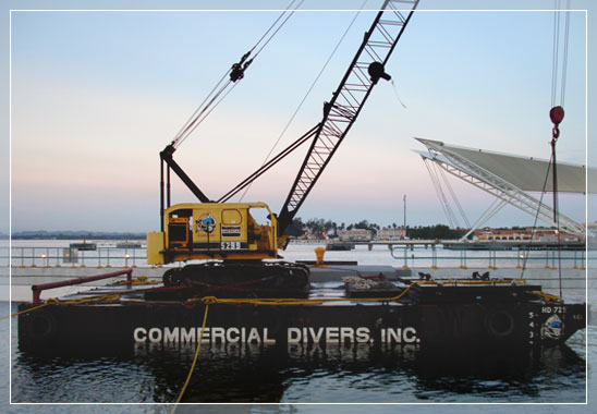 commercial divers barge with crane at work side